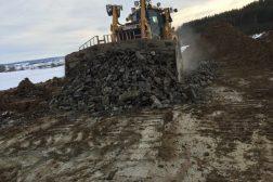 Huser entreprenør nydyrking med doser på Helgøya