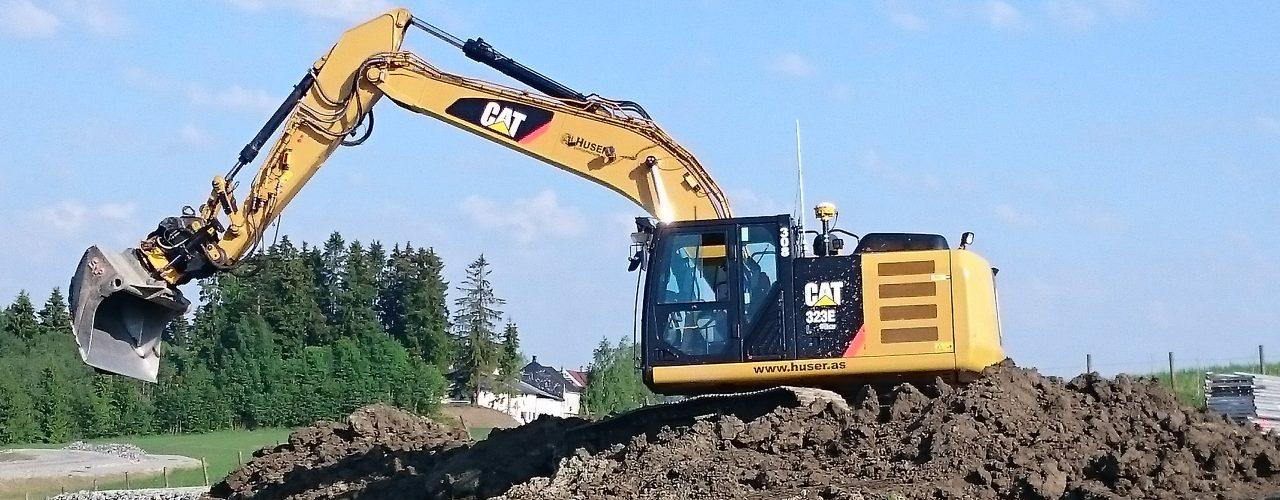 Huser entreprenør utgraving med graver 320E